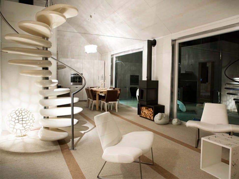moderne Wohneinrichtung mit betonwänden und Designermöbel in weiß