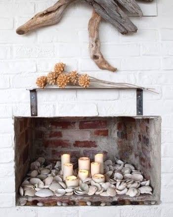 Kerzendekoration mit Muscheln