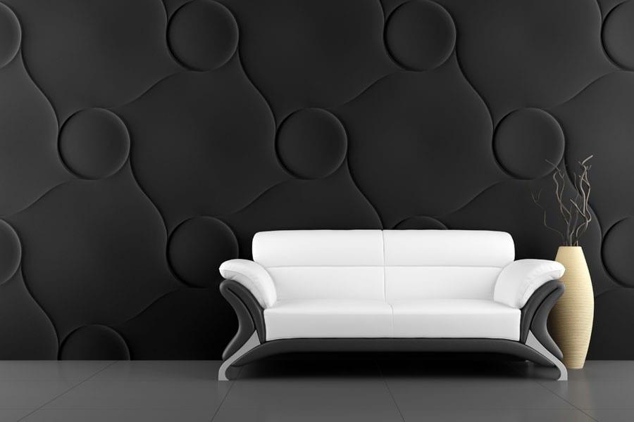 schwarze 3D-Wandpaneele und minimalistisches Sofa in weiß