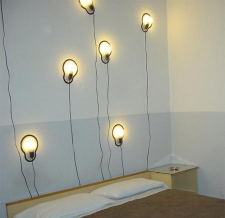 Wandgestaltung mit klebenden Glühbirne-Leuchten