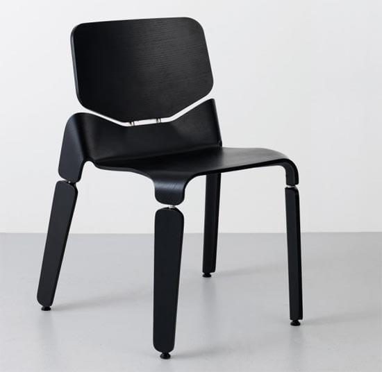 Designer Stuhl fürs esszimmer in Schwarz mit Metallverbindungen