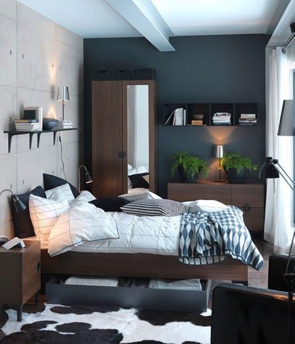 betonwand im schlafzimmer - schwarz gestrichene wand- holzmöbel