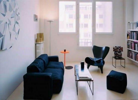 minimalistische wohnzimmer einrichtung mit designer möbeln in schwarz-weiße bücheregale