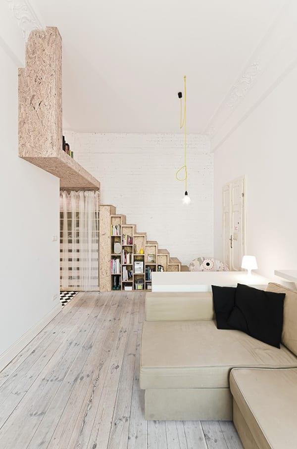 moderne Wohnungsgestaltung mit Bett über Eingangsbereich