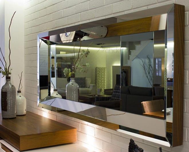 wohnzimmer wandgestaltung mit Spiegel mit rahmen seitlich aus holz und vorne mit spiegel