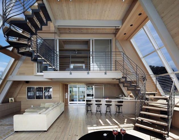 mezzanin design-wohnraum aus holz-offene küche gestaltung-innenraumtreppe-großformatige dachfenster