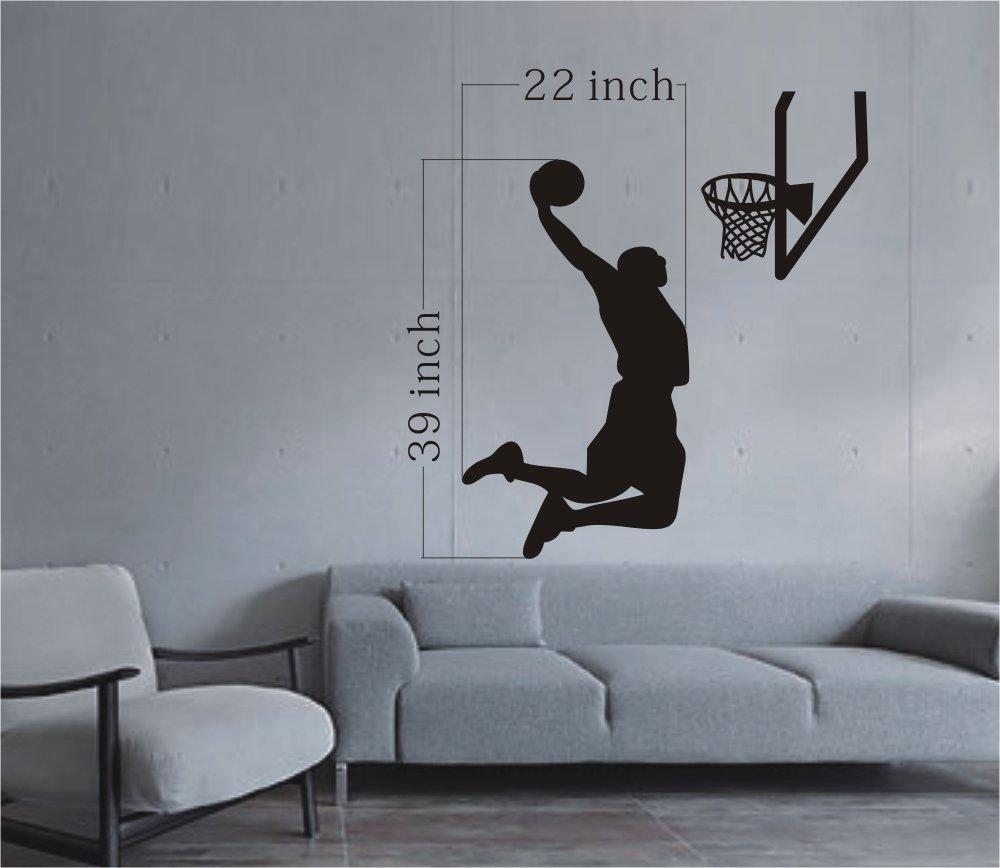 wohzimmer wand dekoration- graue couch- betonwand
