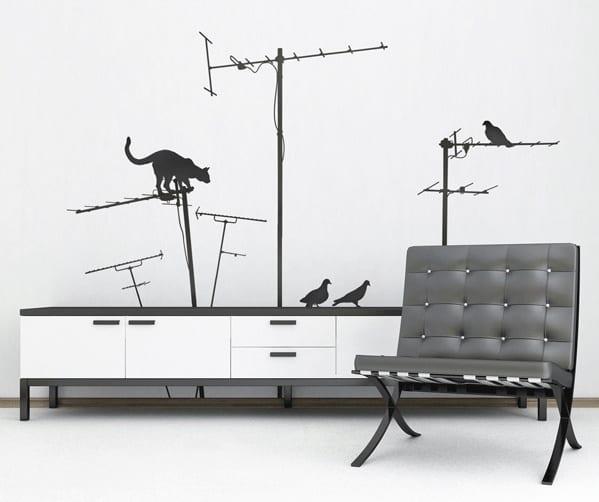 minimalistische wohnzimmer einrichtung - schwarzer ledersessel- wanddeko idee