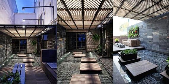 moderne terrasse mit teichbecken und natursteinplatten schwarz