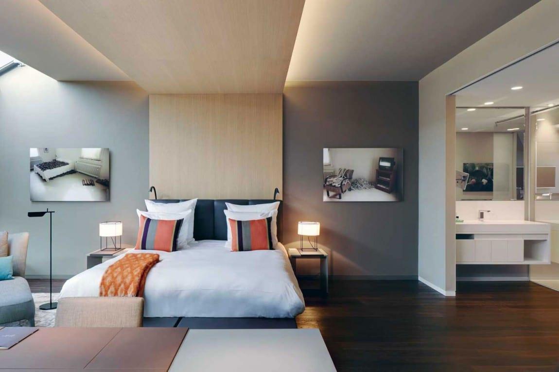 modernes schlafzimmer mit wandfarbe grau und begehbarem Badezimmer