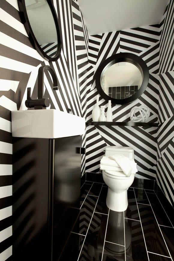 badezimmer streichen- weißer waschbecken mit schwarzem schrank-badezimmerspiegel rund mit schwarzem Rundrahmen-wasserhahn schwarz
