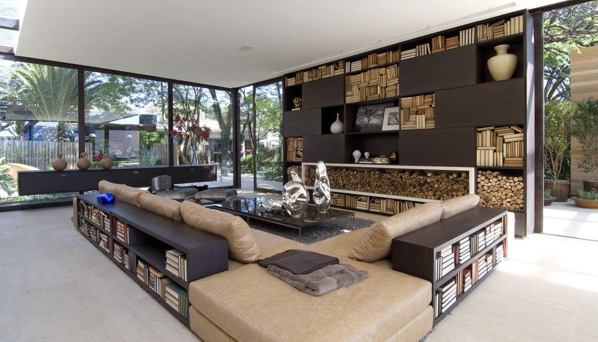 open space wohnzimmer mit wohnwand braun -moderne seats and sofas mit bücherregalen