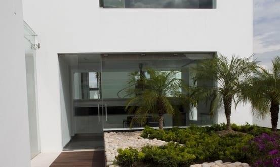 Minimalist house garden landscape wooden path rocks palm for Minimalist house with garden