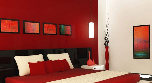 rote wand- bilderrahmen dekorieren- schwarzess bett
