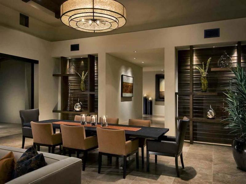 wohnzimmer iterior design in beige und braun-esstisch schwarz mit polsterstühlen orange