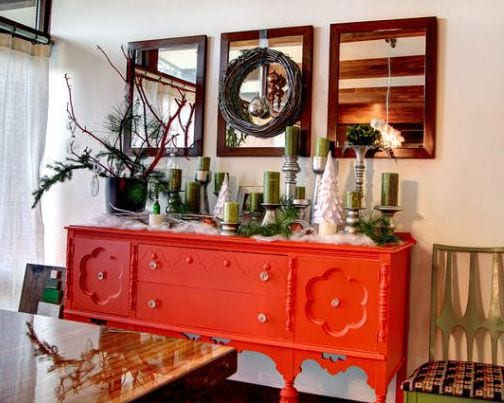 vintage sideboard orange-Wandgestaltung mit bilderrahmen und spiegeln