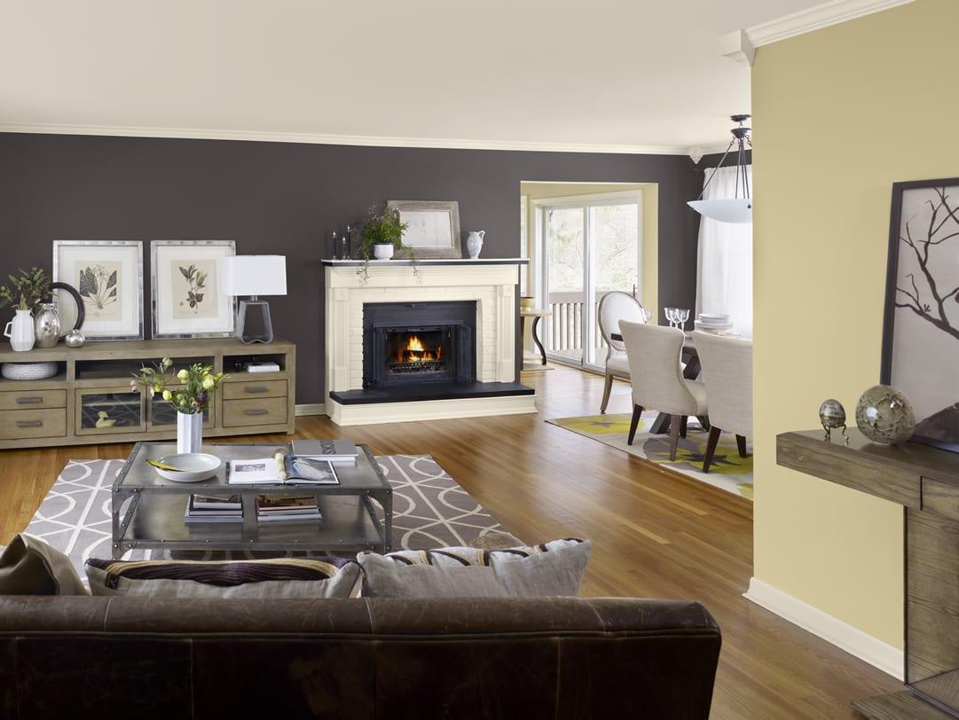 farbgestaltung wohnzimmer in grau und hellgelb-laminatboden mit grauemteppich