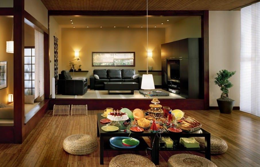japanisches wohnzimmer inspirationen mit rattanbodenkissen-wohnwand schwarz