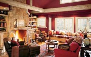 wohnzimmer rot mit runden deckenbalken aus holz in weiß - fresHouse