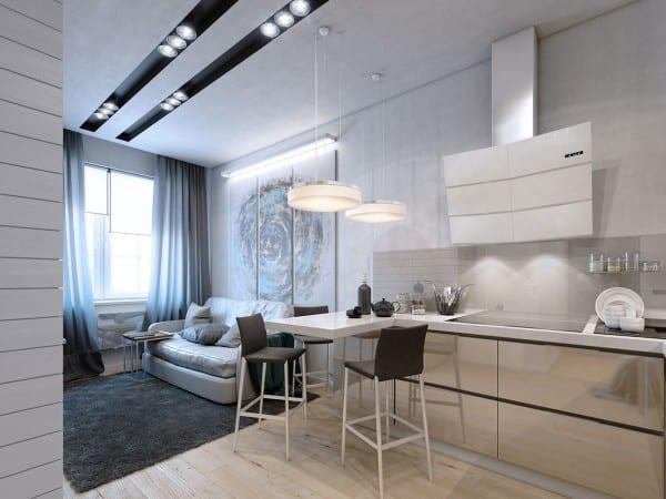 kleines wohn esszimmer mit laminatboden und kleine küche mit metallschränken und weißer theke mit pendelleuchten rund