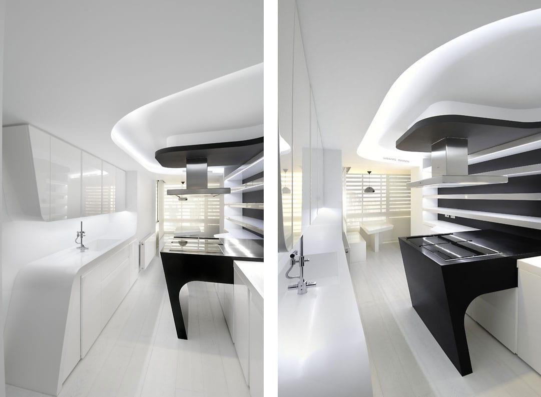 moderne küche weiß mit minimalistischer kückentischplatte in weiß-luxus kochplatte schwarz