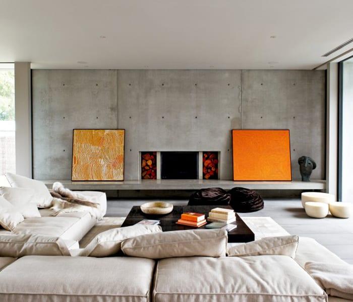 minimalistisches wohnzimmer interior mit kamin - boden und wände aus sichtbeton