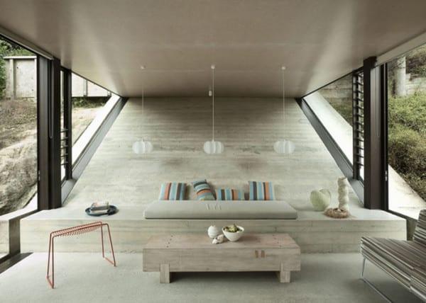 modernes betonhaus am hang eingebaut mit lzxus wohnzimmer inspirationen