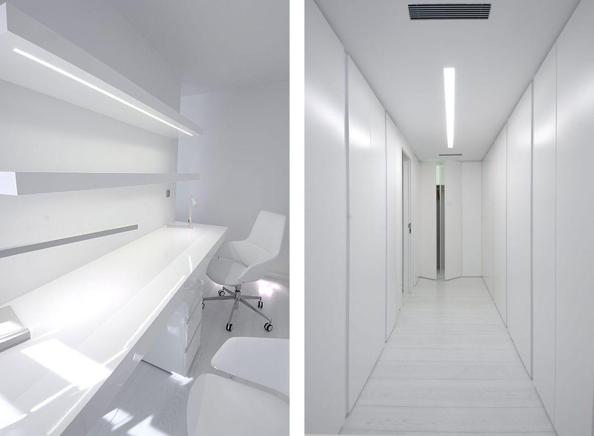wandverkleidung aus weißen wandpaneelen- moderner schreibtisch weiß mit bürostühlen weiß