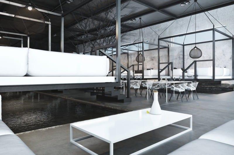 das CUBE restaurant-luxus interior mit hängenden volumen aus metallrahmen in schwarz mit weißer Möblierung