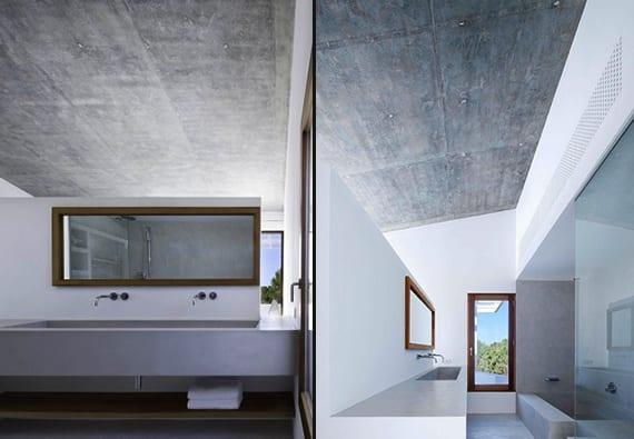 luxus suite badezimmer mit badewanne aus beton und glastrennwand.badezimmer spigel aus iroko holz