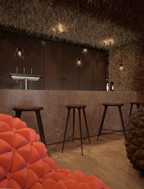 luxus Restaurant Interiot in braunen Farbnuancen und Bar mit minimalistischen Barhockern schwarz