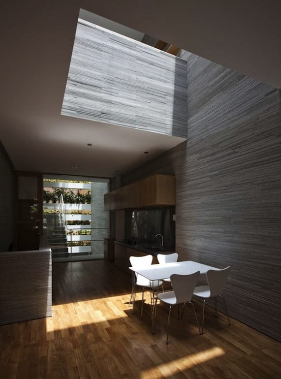 wohnzimmer licht ideen-moderner betonbau mit parkettboden