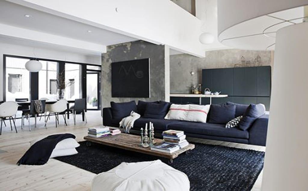 modernes wohn esszimmer mit holzboden und traumteppich schwarz-moderne rollentisch aus holz