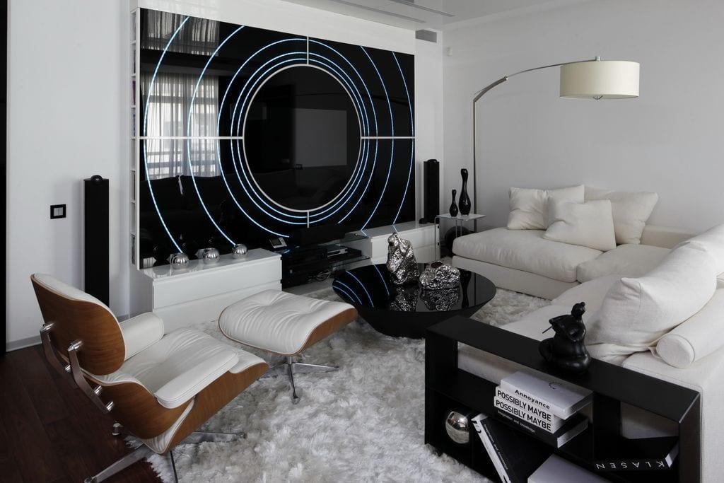 luxus wohnzimmer interior mit ecksofa aus weißem leder und moderne rundcouchtisch schwarz-coole wandgestaltung
