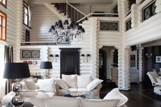ein traumferienhaus aus holz mit weißem interior- innentür schwarz