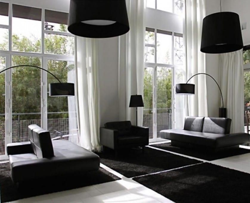 luxus wohnzimmer mit schwarzen teppichen und modernen ledersofas-elegante pendelleuchte schwarz