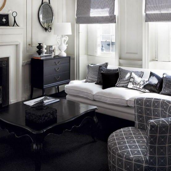modernes wohnzimmer gestalten mit rundsessel grau und rustikalem couchtisch aus holz in schwarz-sideboard schwarz dekorieren