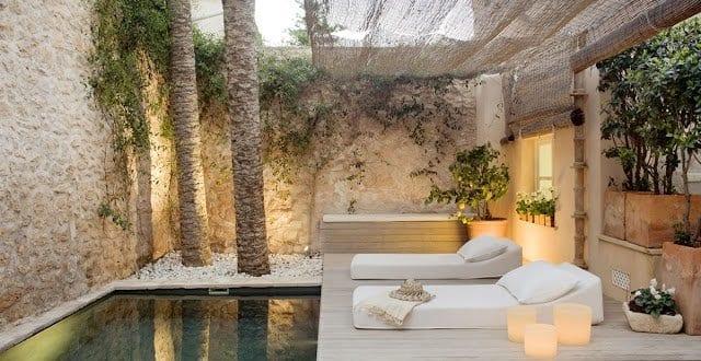 sonnensegel terrasse gestalten mit steingarten und pool f r moderne terrasse freshouse. Black Bedroom Furniture Sets. Home Design Ideas