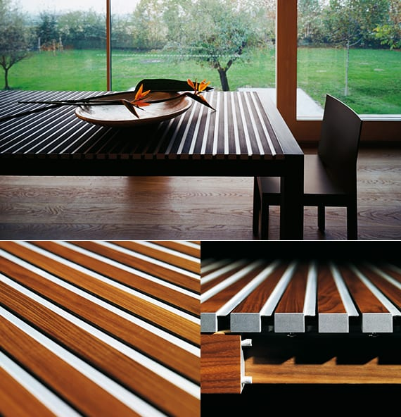ausziehbarer Esstisch massiv aus Holzlatten und Alu elementen