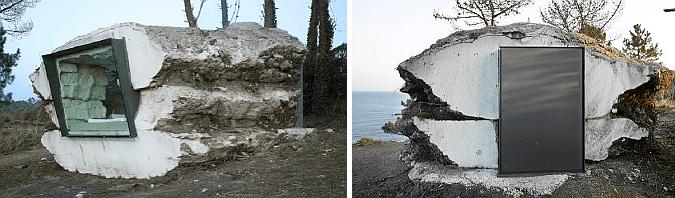 kleines betonbau in form einer Trüffel mit Metalltür und panoramafenster