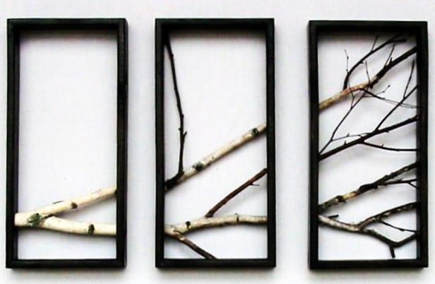 schwarze bilderrahmen dekorieren mit zweigen als kreative wandgestaltung
