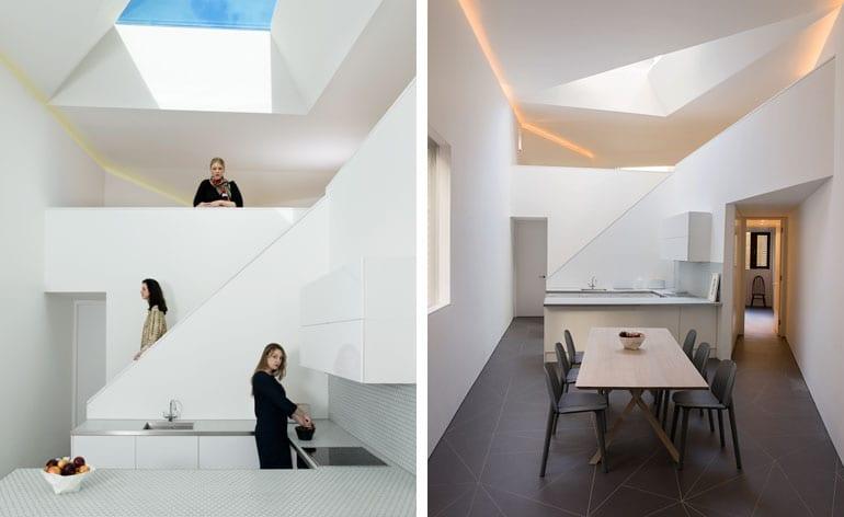 kleine Küche weiß mit weißen Küchenschränken und modernem Esstisch Holz