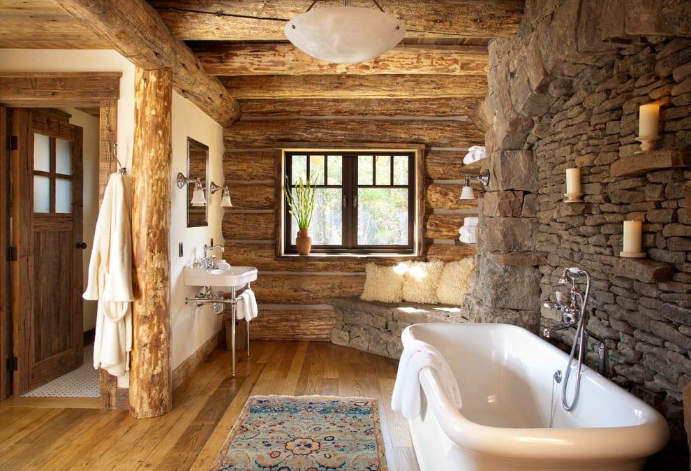 luxus badezimmer aus rundholz und wandgestaltung mit natursteinen  und kerzen