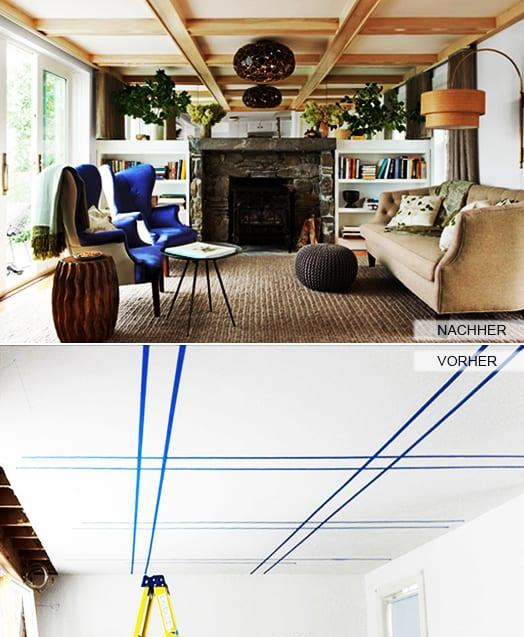 wohnzimmer mit kamin naturstein und weiße kommoden als zimmertrennung