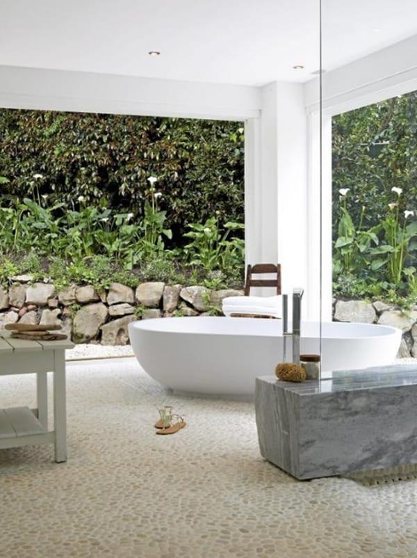 modernes badezimmer weiß mit Glastrennwand und Steinboden weiß