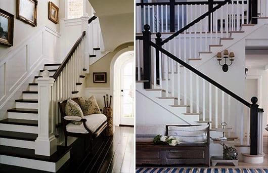 weiße innentreppe mit schwarzen handläufen und schwarzßweiße treppenstuffen