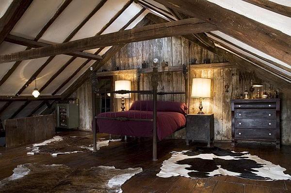 modernes schlafzimmer mit Holuboden und bettgestell rustikal_schlafzimmer streichen idee und gestaltung mit kuhfell