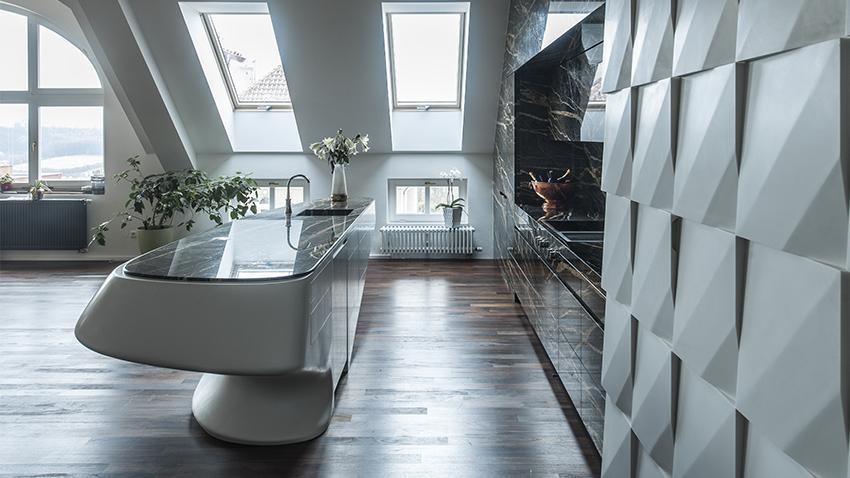 edle küche mit kochinsel und parketboden und moderne 3D wandpaneele weiß