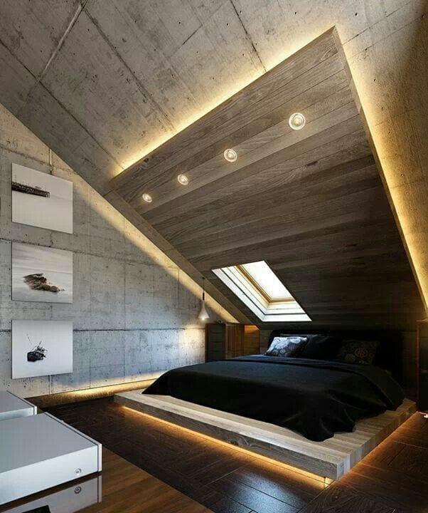 luxus schlafzimmer dachschräge aus beton mit bodenbeleuchtung unter dem bett und dachfenster