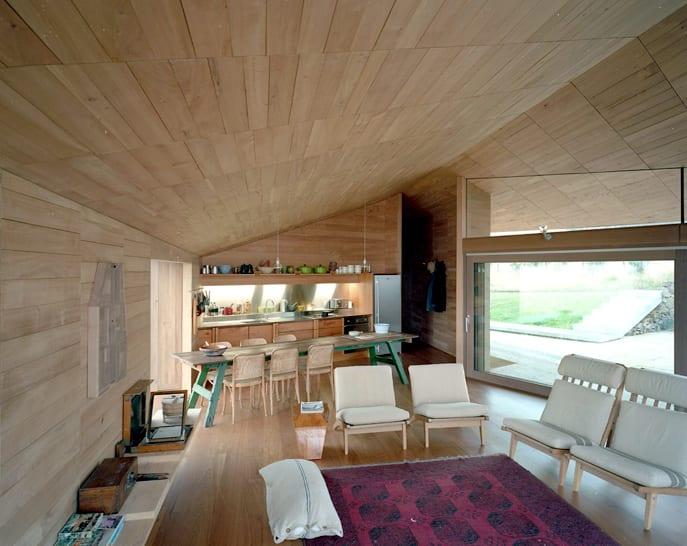 modernes wohnzimmer mit küche und esstisch